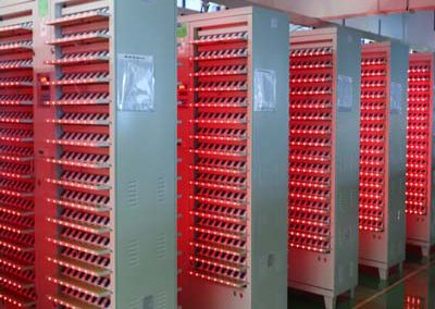 Battery cell formation cabinets
